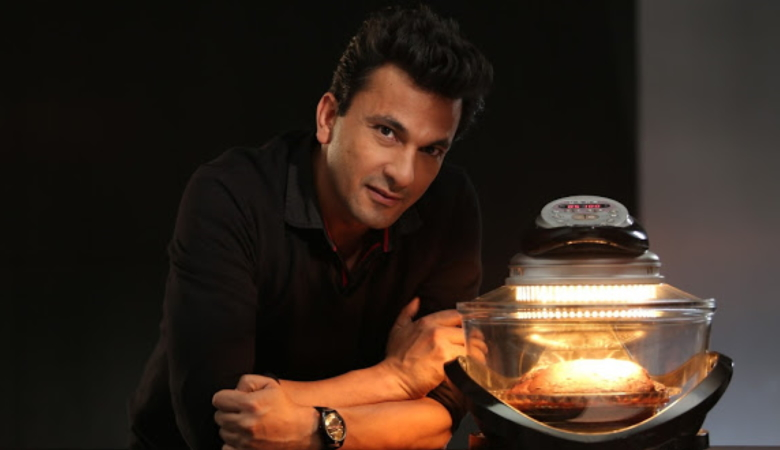 Man Cooking With Halogen Oven
