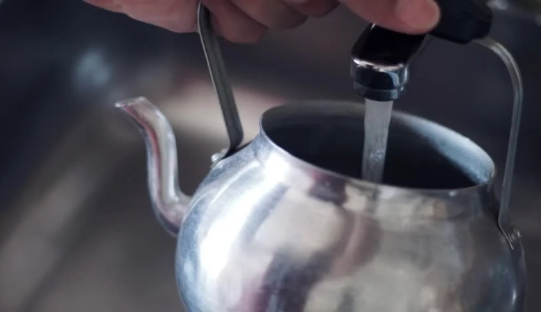 Pouring Water Into the Kettle