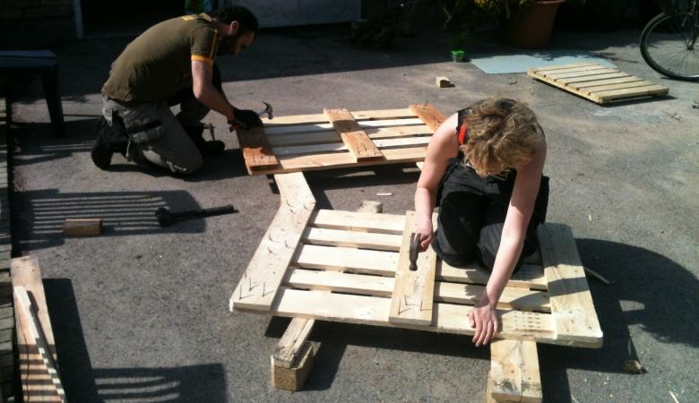 Dismantling Pallet With Hammer